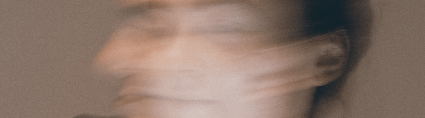 blurred image of woman's face