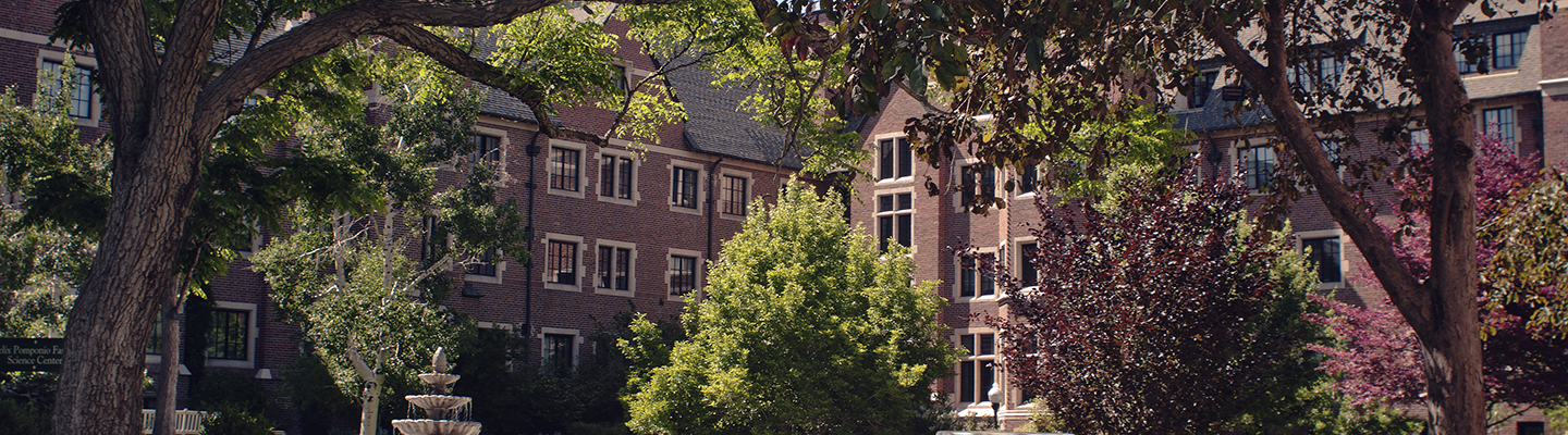 exterior of carroll hall with trees