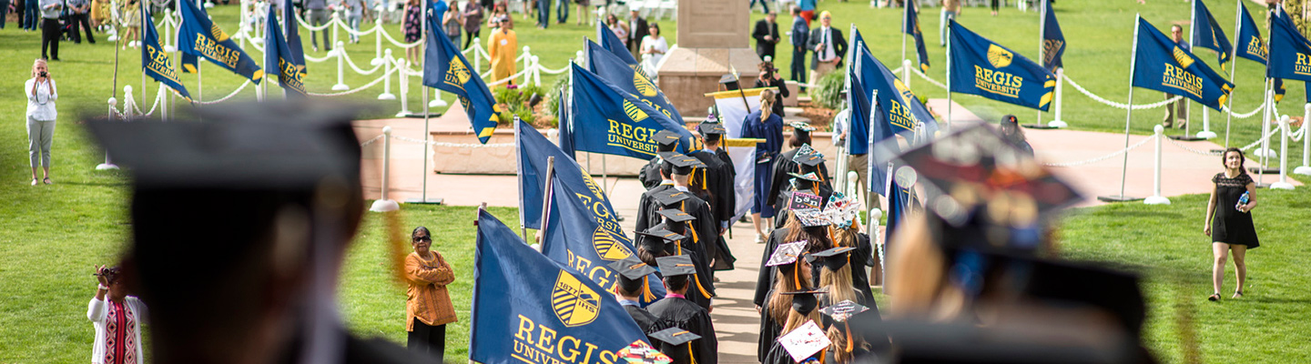 graduates walking at commencement