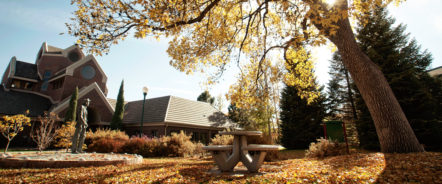 outside Coors with statue and table in fall