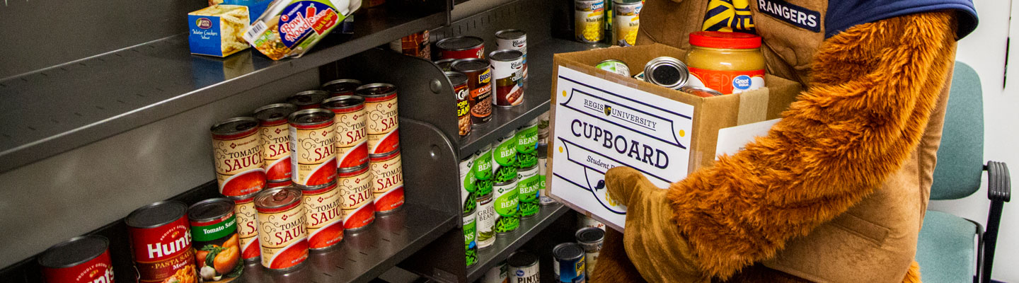 mascot places items on shelves in pantry