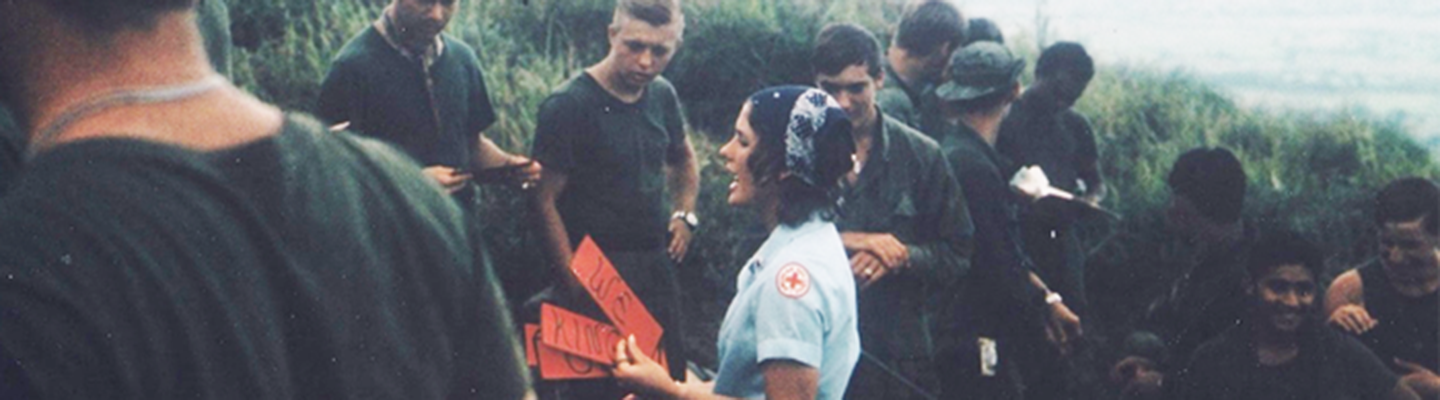archival photo of red cross volunteer and military