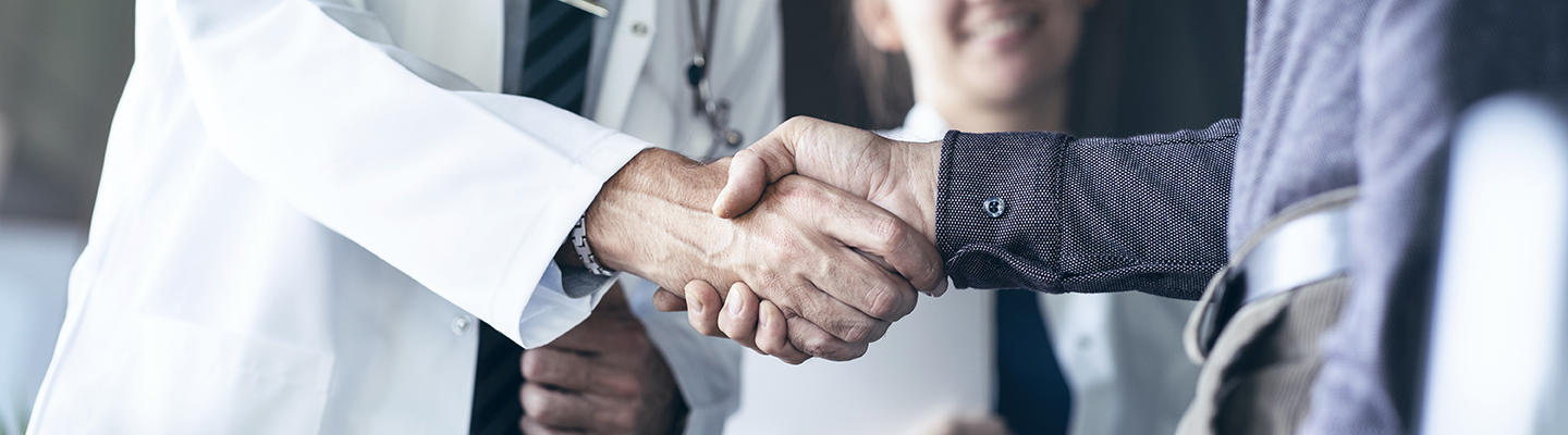 Nursing leaders shaking hands