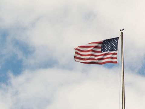 American flag waving in wind