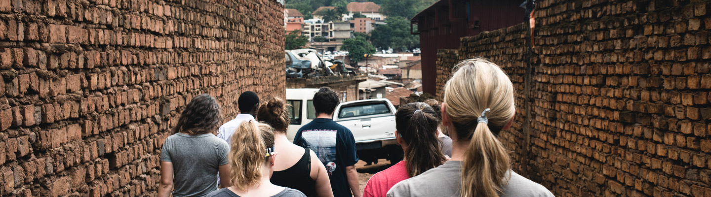 students walk down alley in Africa during SOFE trip