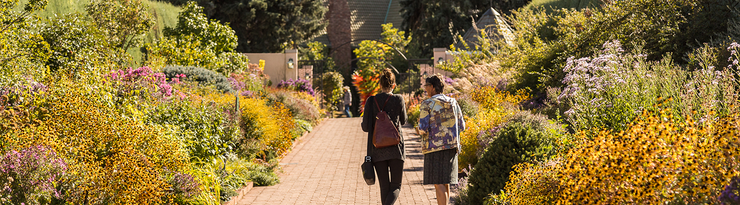 students walking down path at Denver Botanic Gardens