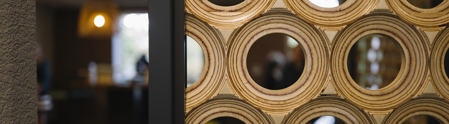 close detail of wooden circles on wall