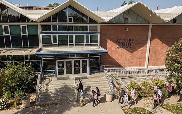 Arrupe Jesuit High School exterior shot with students