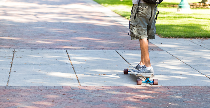 student skateboarding on campus