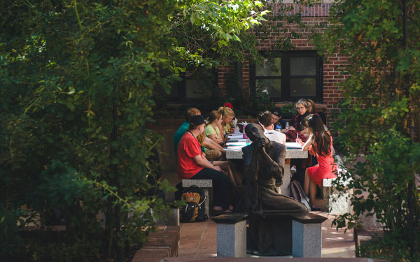 students in class outside in shade