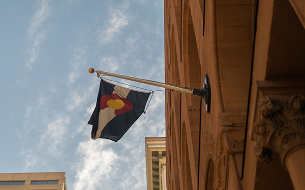colorado flag flying from building downtown