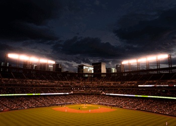 coors field during evening baseball game