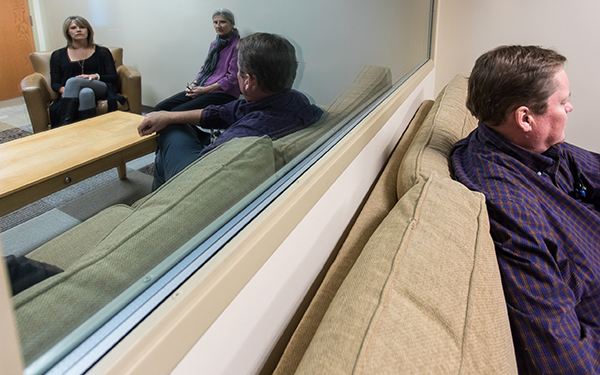mirror view of people talking in counseling room