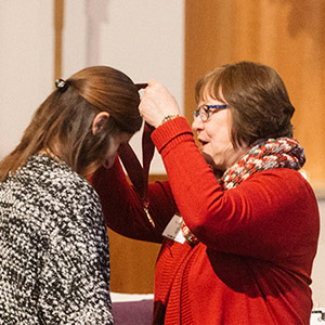 student receives honors medal from provost