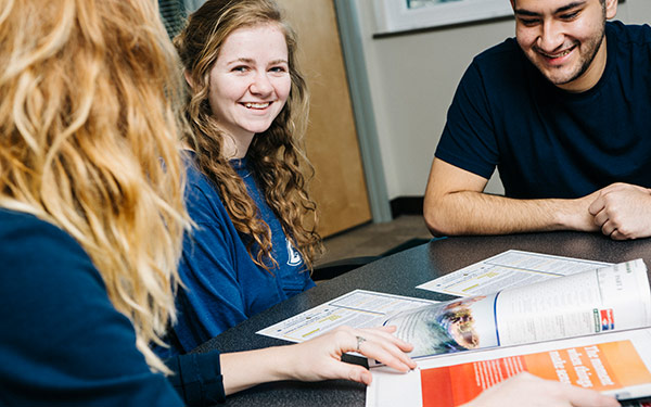 students smiling while studying together
