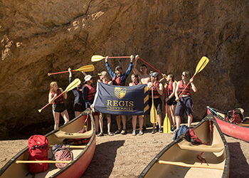 Student take group photo on canoeing trip