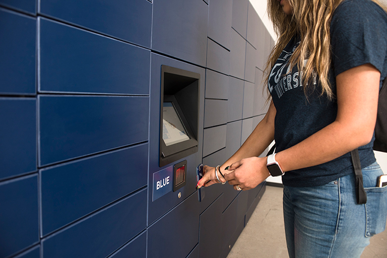 Student using package lockers
