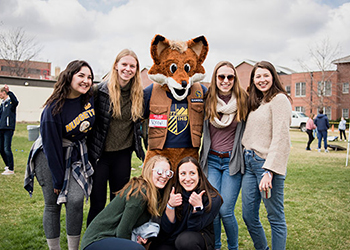 Mascot Regi with a group of students