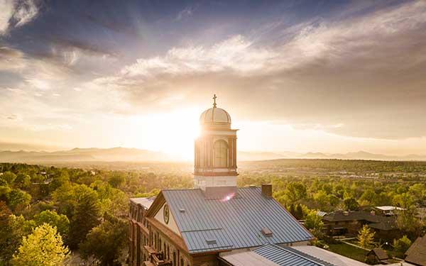 sun sets behind Main Hall cupola