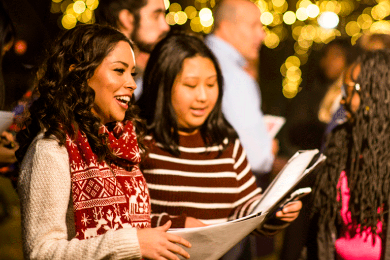 students sing during tree lighting