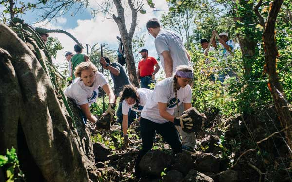 students help locals with landscape work