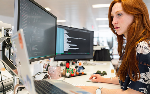 software engineer coding at desk