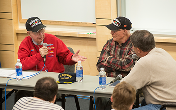 veteran with microphone sharing story
