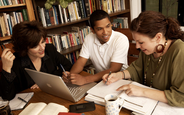 three people studying together