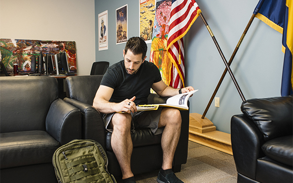veteran student studying with flags in background