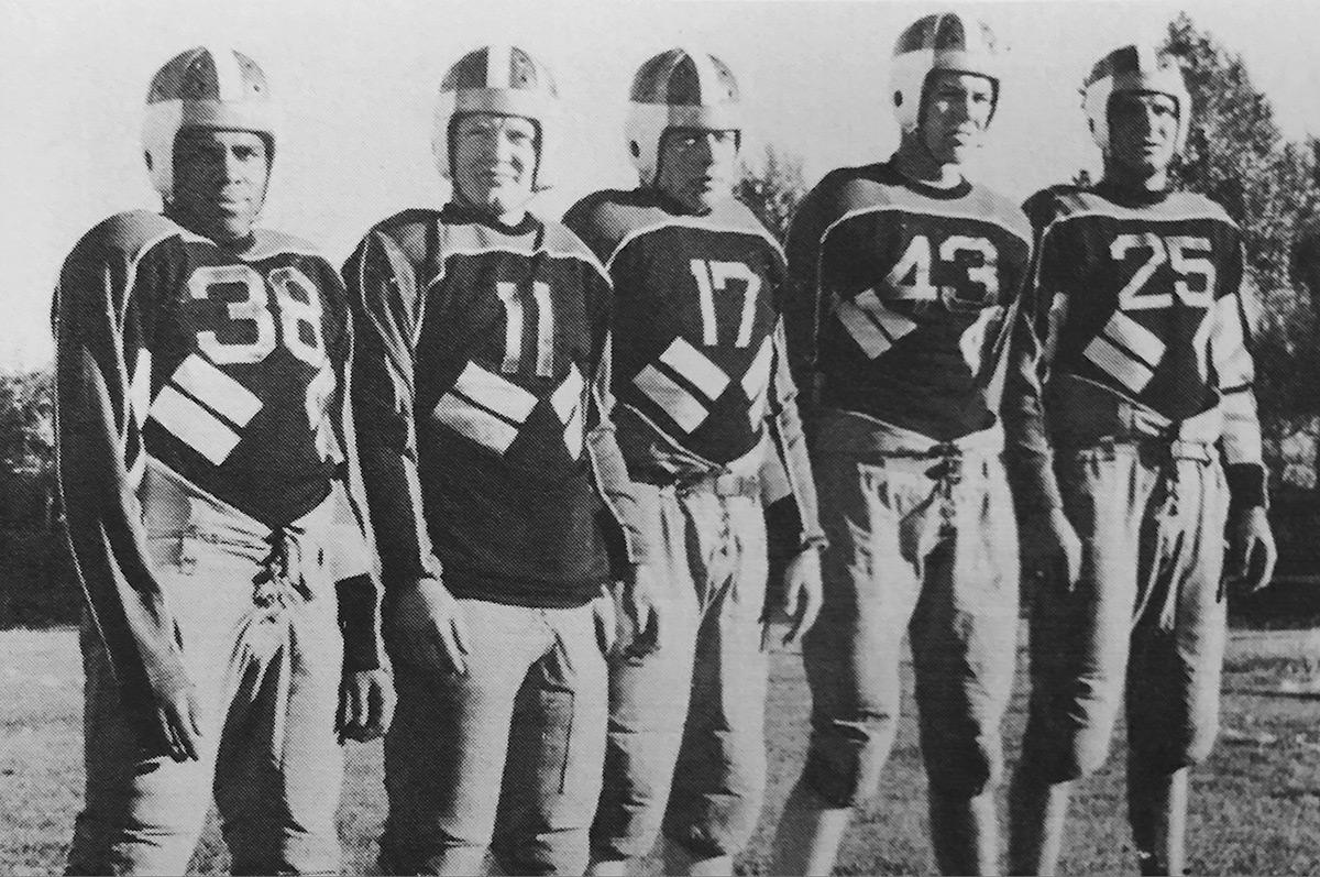 Walter-Springs-In-Football-Uniform-Regis-College-Yearbook-1940-1200x797.jpg