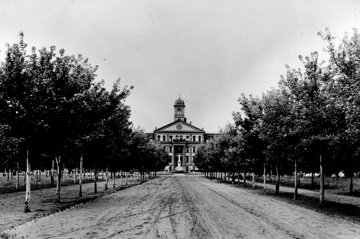 Main Hall stands in the distance circa 1920