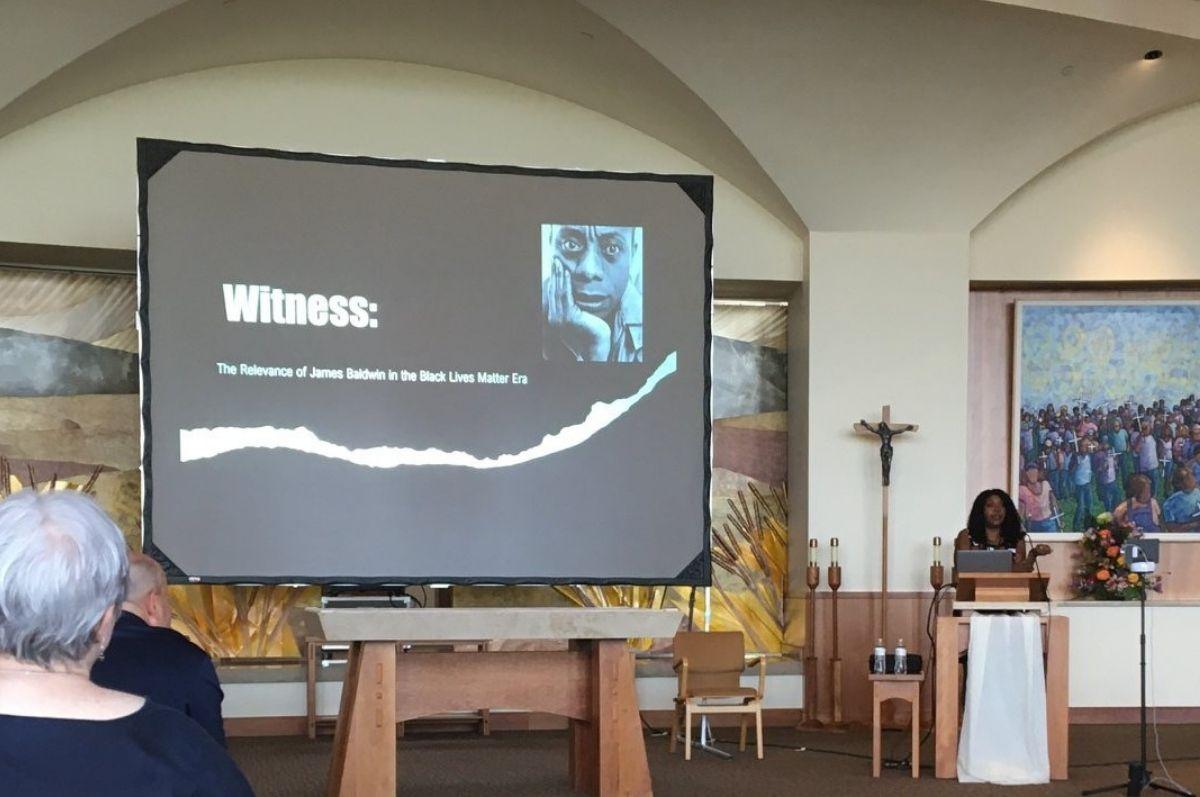 woman presenting beside screen