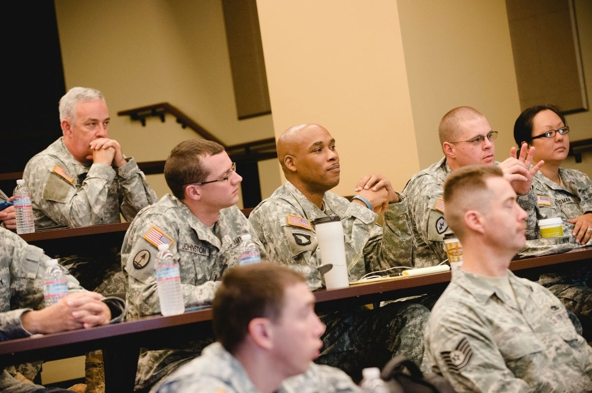 members of military sitting in classroom