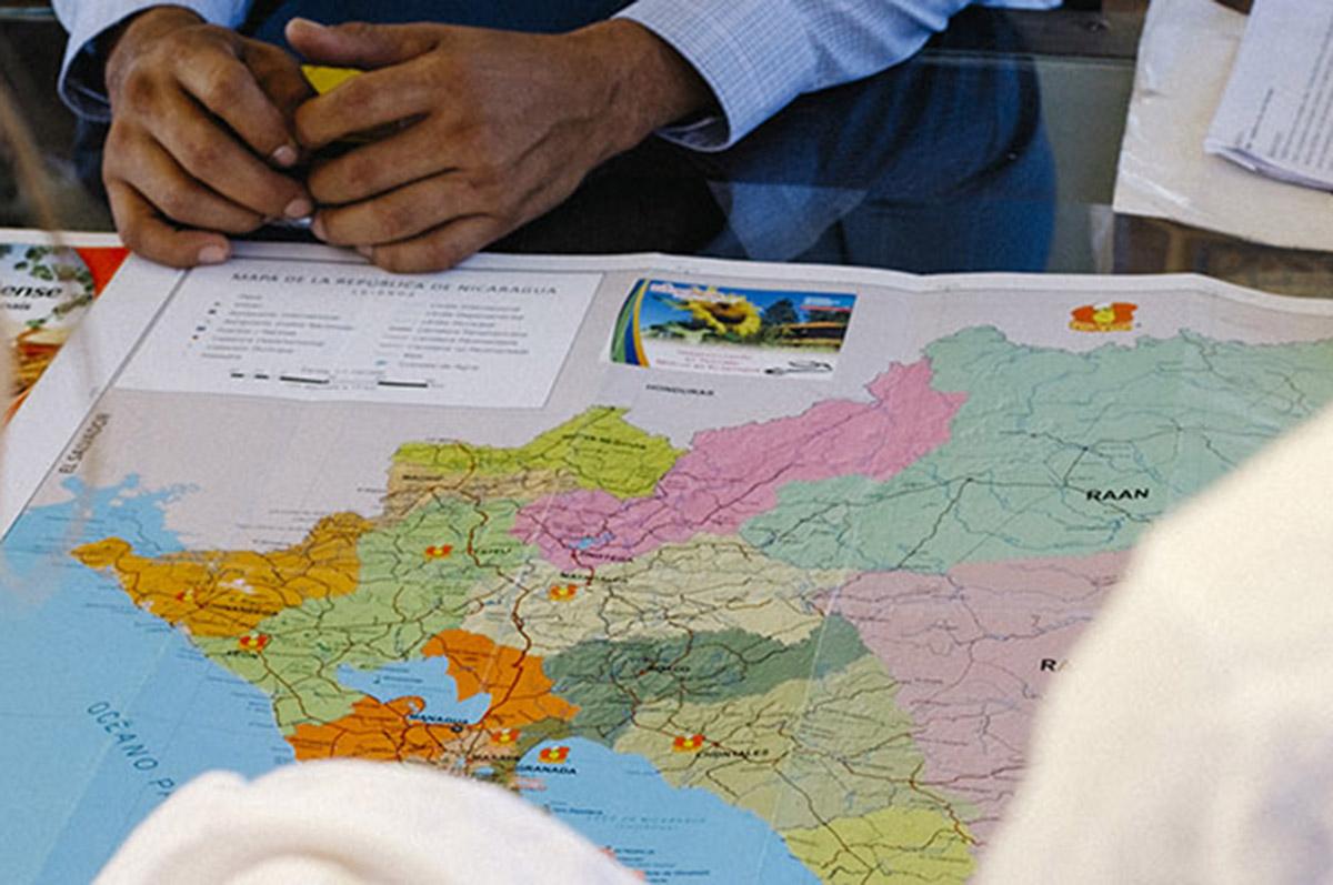 students examining map