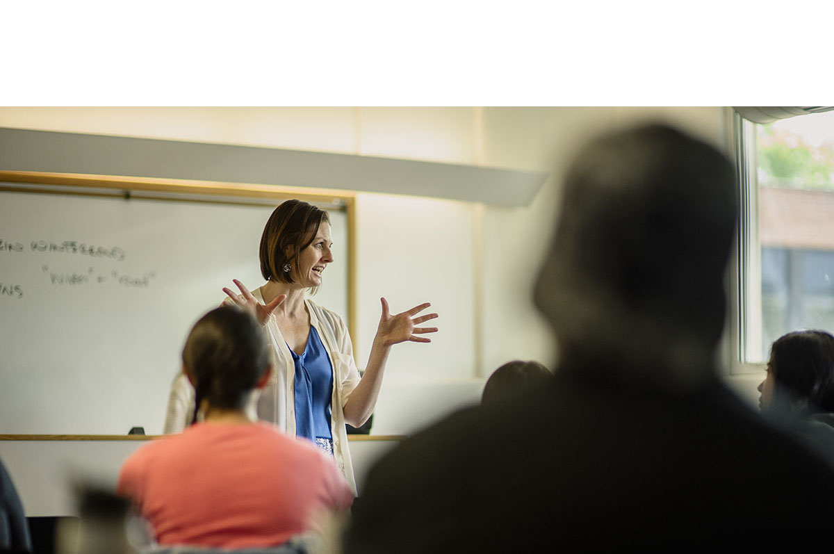 professor actively lecturing in classroom