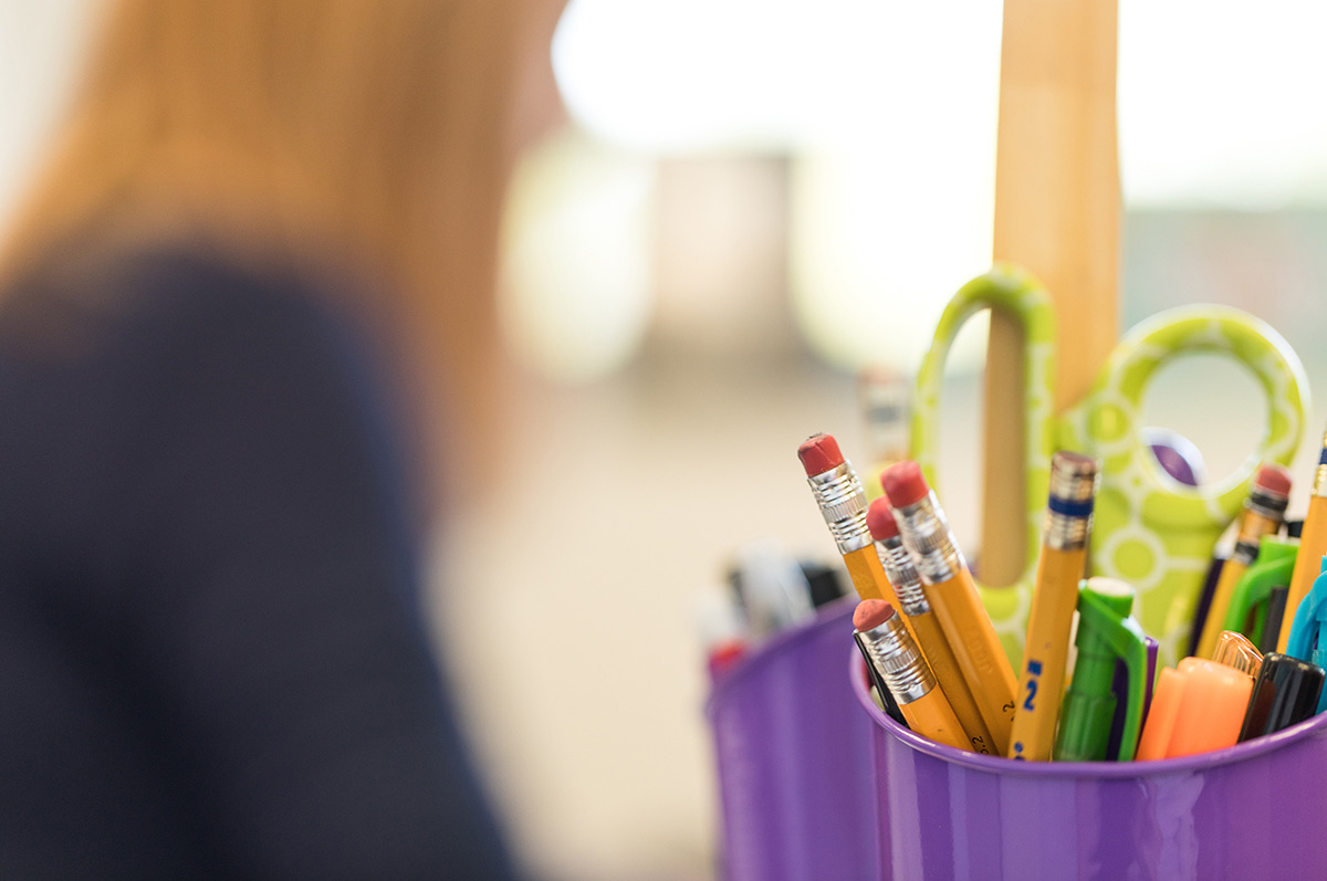 cup of pens and pencils