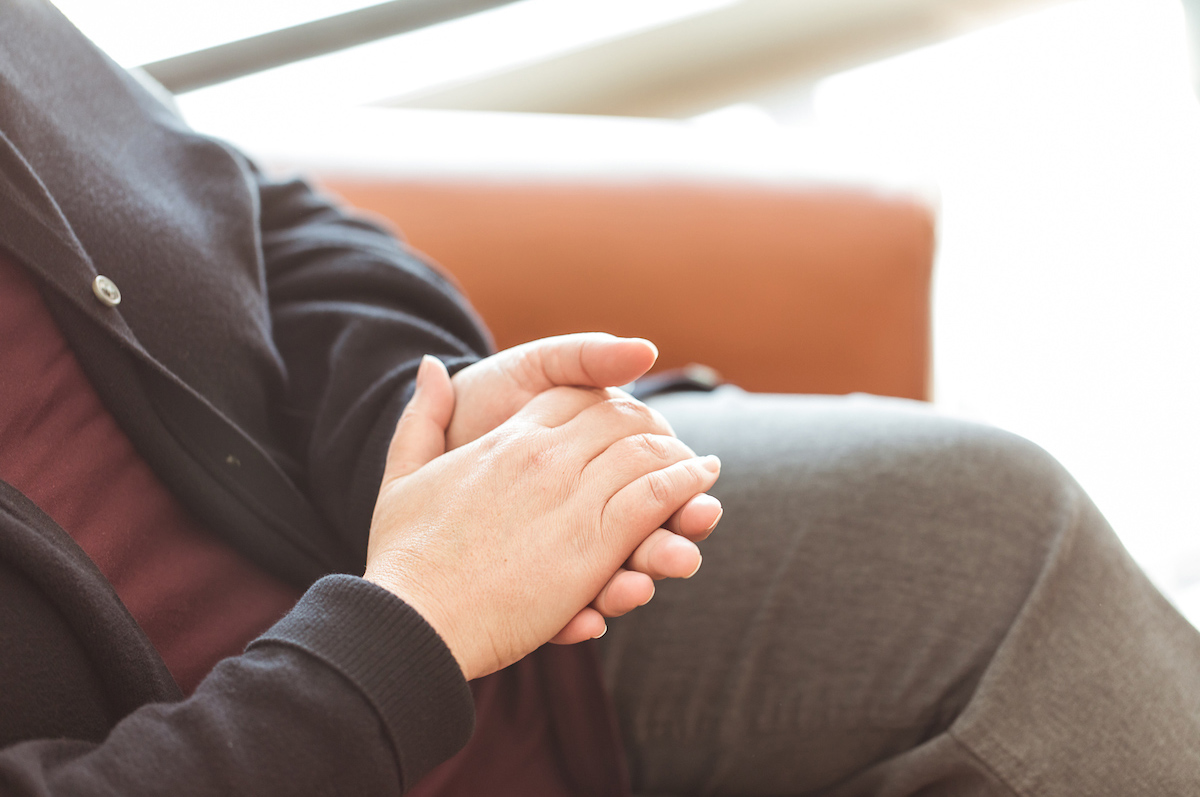 Women with folded hands in therapy